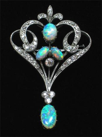 An Edwardian Brooch with four opal stones and an array of diamonds set in 18ct white gold.: Brooches, Art Nouveau, Diamond Brooch, Diamonds, Edwardian Opal, Antique Jewelry, Opals, Vintage Jewelry