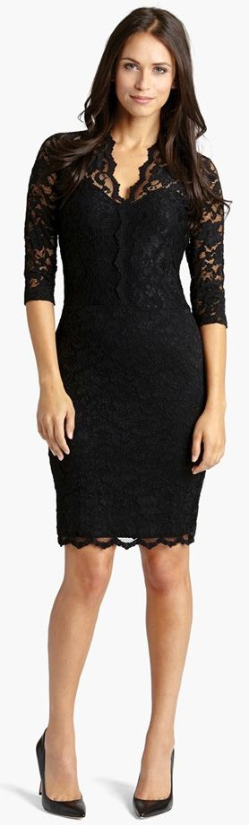 Ebony lace lavishes a curve-hugging sheath styled with a scalloped V-neckline and sheer three-quarter sleeves.