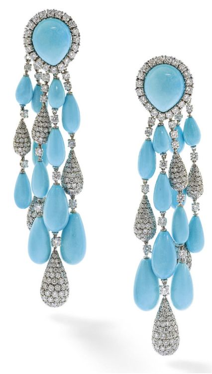 A pair of turquoise and diamond ear pendants, by Vita. Each designed as a cabochon turquoise and circular-cut diamond cluster clip suspending a graduating tassel of turquoise and pavé-set diamond drops to circularcut diamond spacers, length 8 cm, French i