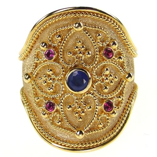 Damaskos Broad Ruby and Sapphire Ring. 18k Gold, Rubies and a Sapphire. See more Greek jewelry at www.athenas-treasures.com