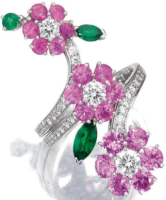 Gem-set and diamond ring, Van Cleef & Arpels. Designed as three flowers set with circular-cut pink sapphires, pear- and marquise-shaped garnets, highlighted with brilliant-cut diamonds, mounted in white gold, size 56, signed Van Cleef & Arpels and