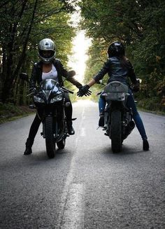 Two women crossing paths on a motorcycle ride - see more cool motorcycle goodness at http://www.youmotorcycle.com