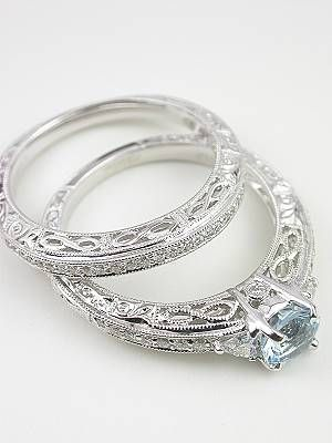 Antique Style Filigree Wedding Band and engagement ring- I'm obsessed with this type of ring in general, but this particular one is just perfect. Everything I ever imagined as a little girl. Simple center diamond with small diamonds surrounded by swir
