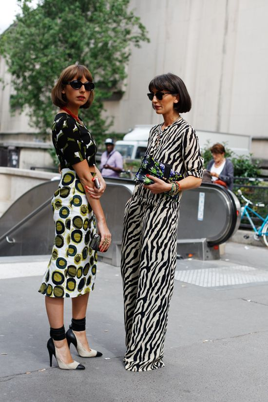 Mix prints + printed top + printed skirt + color block shoes + zebra print + jumpsuit + bob haircut