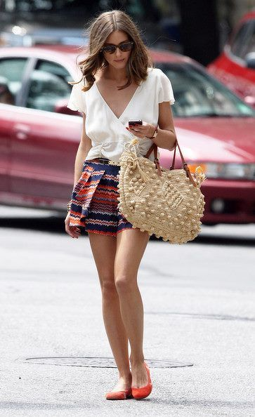 Simple white v-cut wrap blouse. Patterned skirt.