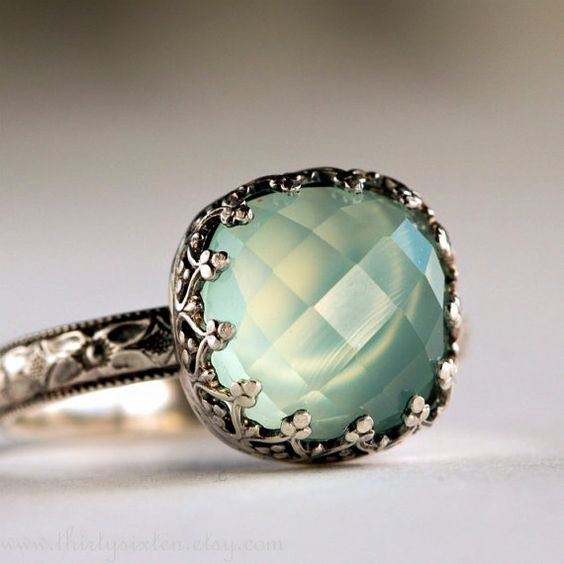 Aqua Chalcedony Cocktail Ring in Sterling Silver: Chalcedony is a variety of the mineral quartz that occurs in in a great variety of colors inlcuding blue, lavender, white, buff, light tan, gray, yellow, pink, red or brown. If chalcedony is conspicuously