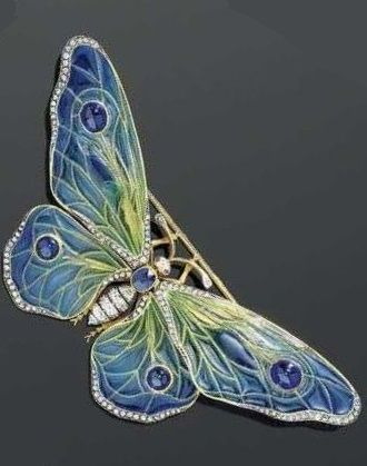 ENAMEL, DIAMOND, SAPPHIRE, AND RUBY BROOCH, circa 1890. Designed as a butterfly, the wings mounted en tremblant, the body set with one oval sapphire and old-mine-cut diamonds. The wings decorated with plique-à-jour enamel in blue-green tones, and set with