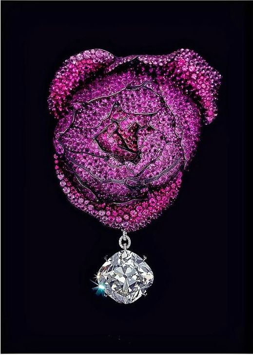 https://www.bkgjewelry.com/ruby-rings/208-18k-yellow-gold-diamond-ruby-solitaire-ring.html Rose Brooch by JAR Paris, composed of Rubies, Sapphires, Spinels, Diamond, Silver, Gold.