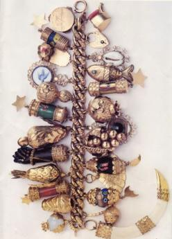 "Jackie Kennedy's Charm Bracelet ""And then the jewels. Left to her own tastes, Jacqueline Kennedy went for the bold and unusual, like the charm bracelet bunched with fish, birds, fruit and a moorish black hand"" http://www.nytimes.com/1996/03/06"