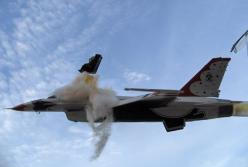"""Capt. Chris Stricklin ejects from the USAF Thunderbirds number six aircraft less than a second before it impacted the ground at an air show at Mountain Home Air Force Base, Idaho, Sept. 14 2003. Stricklin, who was not injured, ejected after both guid"
