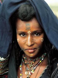 Africa | Portrait of a Wodaabe woman in Niger.  Her face combines both permanent tattoos and face painting elements |  Just one of the many fantastic photographs included in the publication 'Painted Bodies: African Body Painting, Tattoos and Scarifica