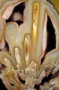 """Agate    """"The quartz crystals in agate is said to be cryptocrystalline - which means that it has a crystalline structure so fine that no distinct particles are recognizeable by the naked eye, nor under the microscope, with regular magnification."""":"""