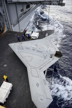An X-47B Unmanned Combat Air System (UCAS) demonstrator aircraft is transported on an aircraft elevator aboard the aircraft carrier Harry S. Truman (CVN 75).: Drone, Aircraft Carrier, Combat Air, Airplane, Air System, Harry Truman