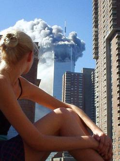 Australian model caught distracted during a photo shoot when the first plane hit tower one. What an epic photo.: 9 11, Caught Distracted, Plane Hit, Photoshoot, 911, Hit Tower, Model Caught
