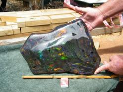 Black Opal: At 55,000 carats, this opal matrix recently found in the opal fields of South Australia is the world's largest. Discovered by Stuart Hughes and his partners, it is valued at over one million dollars and outweighs the previous record holder by