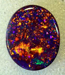 Black Opal is Australia's national gemstone, and black opal is the rarest and most valuable of its kind, at times selling at prices that rival the best diamonds.  The stone must have a rich, black background, but base colors come in all shades of gray, wh