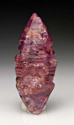 Corundum var. Ruby, elestial: Corundum is best known for its gem varieties, Ruby and Sapphire. Ruby and Sapphire are scientifically the same mineral but just different colors. Corundum is a very hard, tough, and stable mineral. For all practical purposes,