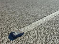 """Death Valley is world famous among geologists for its unique """"sliding rocks"""". However, no one has ever seen these sliding rocks in motion, leaving many different theories as to how they ultimately move about the playa.: Geology, Moving Rocks, Playa Additi"""