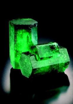 "Fine natural emerald crystal from the Muzo-La Pita mining area.  Jeff Scovil. Courtesy: Gonzalo Jara.    Experts describe emerald's brilliance as ""satiny,"" like the luster of a satin ribbon. Emerald has a softness which contrasts with the ""crisp"" brillian"