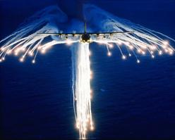 From Wikiwand: A Hercules deploying flares, sometimes referred to as Angel Flares due to the characteristic pattern.: Angel Flight, Aviation, Angel Flare, Military Aircraft, Air Force, Photo