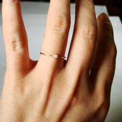 Items similar to Natural AAA Opal on a Thread of Gold - Simple Stacking Ring - Flashing Colors in a Tiny Fiery Stone - Delicate Jewelry on Etsy $31.00: Simple Beautiful, Beautiful Stack, Golden Orbital, Fiery White
