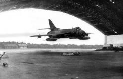 Jet flying through hanger with man on the ground: Aeronautical Photography, Hunters, Airplane, Aircraft, Aircraft Airforce, Planes Aircraft, Hawker Hunter, Aircraft Fun