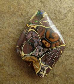 koroit boulder opal with a variety of chocolate brown colors, textures and patterns of cream and bluish opal on ironstone, this one has a bit of sparkling blue and green fire, and some multicolor pinfire.: Green Fire, Pattern, Chocolate Brown, Brown Color