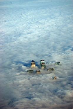 London, England from a plane. I have seen it like this before! Once you break through the clouds, you see all the red double decker busses... and they look like tiny toys. Oh I'm in love.: Picture, Clouds, Canary Wharf, View, Travel, Places, London En