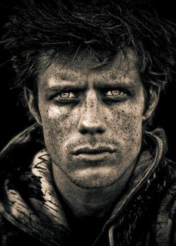Love the tone, saturation, contrast and the detail of the freckles. Man, male, face, portrait, intensity, intense eyes, I wonder what he have been experiencing - first thought a soldier returned home from war - his eyes are telling stories. Face, stunning