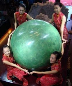 Mongolia. The stone, (5 ft high, weighing six tons) formed mostly of fluorite mineral, glows green in the dark and in China is prized more highly than diamonds. The finders took three years to grind the raw gem down to its pearl shape. It has gone on show