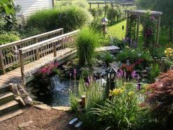 Pond, stream and bridge are enhanced by annuals and perennials in this backyard.: Ponds, Idea, Water Features, Outdoor, Gardens, Bridge, Backyard, Water Garden