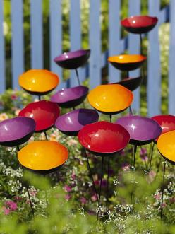 "Poppy Sways, Set of 5 (3 sets in photo)  -- Powder-coated steel, copper plate; Approx. 4"" W x 24"" H; Add an extra splash of color to your garden. These steel poppies sway in the breeze and collect rainwater for butterflies or can be filled with a"