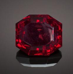 RARE GEMSTONE: CUPRITE - 93.6 CT. Emke Mine, Ongangja, Seeis, Khomas Region, Namibia This rare gemstone is a companion piece to Lot 87011 on an earlier section of this auction. All large gemstones of this mineral are most likely derived from this one-time
