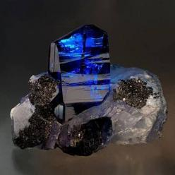 Tanzanite, one of December's birthstones, is relatively new to the colored stone galaxy. As the most common story of the tanzanite mining boom goes, in 1967 a Masai tribesman stumbled upon a cluster of highly transparent, intense blue crystals weather