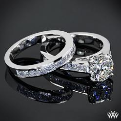 This gorgeous custom combo features a total of 1.45ctw channel-set princess diamond melee and is set in 18k white gold. The lovely 4 prong head holds a 1.62ct Round Brilliant Diamond.: Diamond Engagement Rings, Channel Set Diamond, Diamond Wedding Rings,