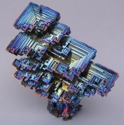 This is a picture of a naturally-occurring Bismuth crystal. They are amazing and have awesome commercial and pharmaceutical benefits… but not for your skin. Many makeup companies use a derivative of this ore in their cosmetics because it has that beautifu