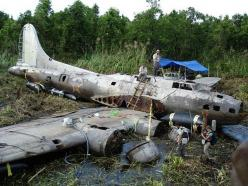 "This is the Boeing B-17E Flying Fortress known as the ""Swamp Ghost"", serial number 41-2446, which crash landed in Agaiambo swamp near Papua, New Guinea in 1942, during the start of salvage operations.: B 17, Swamp Ghost, B17 Flying, Flying Fortres"