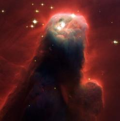 This photo from NASA's Hubble Space Telescope shows an ominous pillar of gas and dust known as the Cone Nebula. The image shows the top portion of the nebula that is 2.5 light years in height. The Cone Nebula is 2,500 light-years from Earth in the Mon