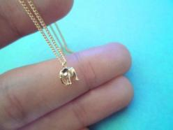 Tiniest Baby Elephant on Gold Plated Chain  This elephant is really small yet has everything from eyes to 4 legs  very delicate work   comes with sturdy finest 15 gold plated chain  Adorable Necklace: Elephant Present, Elephant Necklace, Elephant Jewelry,