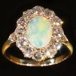 vintage opal and diamond engagement ring. those are some big rocks around the outside though!: Opal Engagement Ring, Diamonds, Wedding Rings, Victorian Engagement Rings, Antique, Opals