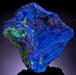 whateveramusesme:  Azurite Azurite owes its name to its beautiful azure-blue color, which makes it a very popular and well-known mineral. It usually occurs with green Malachite, which may form green stains or specks on Azurite crystals or aggregates. The