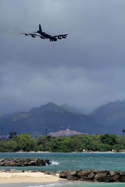 A B-52 Stratofortress strategic bomber conducts a low approach training flight over Hickam Air Force Base, Hawaii April 2, 2014. Two B-52 Stratofortress strategic bombers from Barksdale Air Force Base, La. and two B-2 Spirit strategic bombers from Whitema