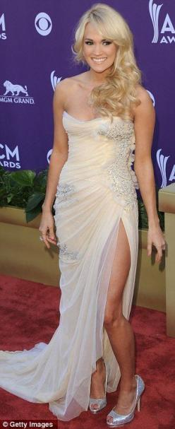 A Dress I though Cristin would like,  a strapless cream gown by Abed Mahfouz that was embellished with beads and boasted an asymmetric cut.    Read more: http://www.dailymail.co.uk/tvshowbiz/article-2123797/ACM-Awards-2012-Taylor-Swift-Miranda-Lambert-Car