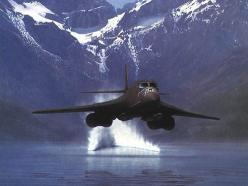A USAF Rockwell B-1 Lancer supersonic bomber skimming the surface of a lake NOE (Nap Of The Earth):
