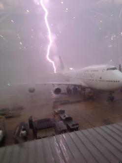 Air New Zealand: A bolt of lightning hitting an Air New Zealand plane while parked at the terminal.: Photos, Airplane, Weather, Storms, Mother Nature, Planes