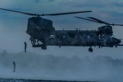 Airmen from the 23rd Special Tactics Squadron at Hurlburt Field, Fla., jump out of an MH-47 Chinook helicopter April 9 at Wynnehaven Beach, Fla.: 23Rd Special, Wynnehaven Beach, Air Force, Tactics Squadron, Christopher Callaway, Mh 47 Chinook, Photo