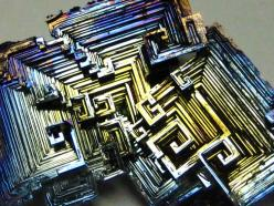 Bismuth (element #83 on the periodic table) forms beautifully colored and geometrically intricate hopper crystals, shown in the image to the left, as it slowly cools and solidifies from its molten state.: Gems Crystals Minerals, Nature, Stones Crystals Mi