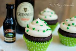 Chocolate Stout Cupcakes with Irish Cream Buttercream…..Slainte!!    I kind of went overboard with them. They literally SCREAMED St. Paddy's Day with a decadent Guinness Beer cupcake, filled with a chocolate truffle, with spirals of green Baileys buttercr