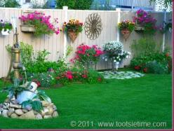 decorating a garden fence, love this idea very much!  wall art, birdhouses, etc...don't know if I could keep that many flowers alive but I could try!: Privacy Fence, Decorating Fence, Idea, Outdoor, Wooden Fence, Backyard, Garden