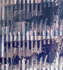 In these two photographs of the gaping hole made by the plane crashing into the South Tower of the WTC on 9/11, you can see a woman standing on the edge of the hole waving. Her name is Edna Cintron, and the mystery many people say of these photos is that